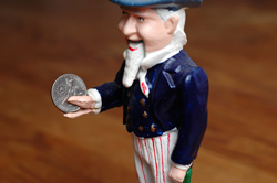 Uncle Sam, Holding a Dime